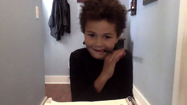 a young mixed race child tries to concentrate while in a zoom class - pencil stock videos & royalty-free footage