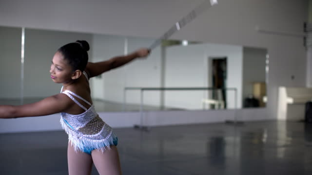 ms young mixed race girl doing a routine with a baton. - routine stock videos & royalty-free footage