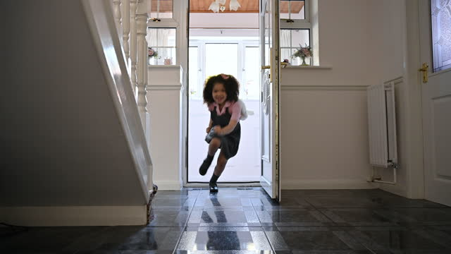 young mixed race girl returning home from school with mother - landing home interior stock videos & royalty-free footage