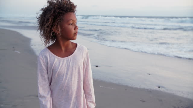 young mixed race girl walking on the beach - pre adolescent child stock videos & royalty-free footage