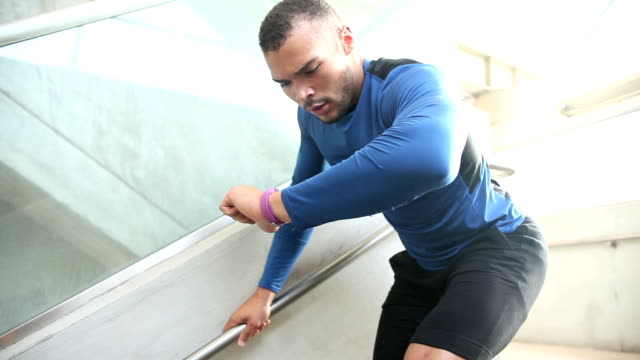 young mixed race man, athlete training for event - fitness tracker stock videos and b-roll footage