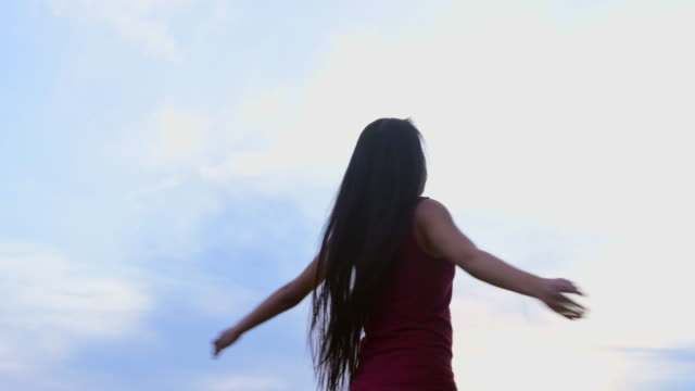 young mixed race woman spinning around. - exhilaration stock videos & royalty-free footage