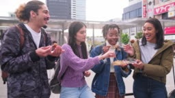 Young Mixed-Ethnic Group Enjoying Outdoor Snack in Tokyo