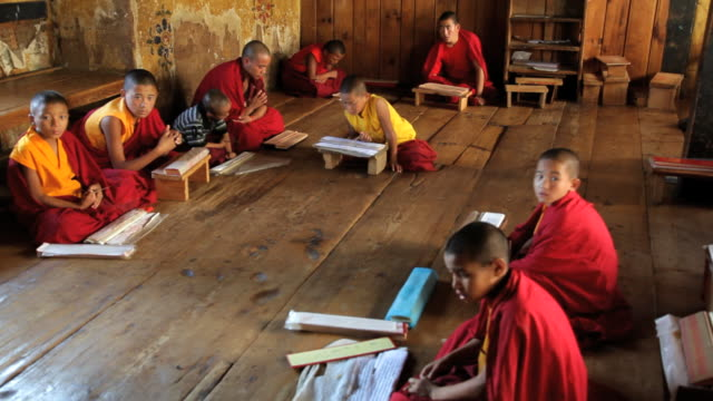 young monks studying for there education, chimi lhakhang monastery, pana, bhutan, asia - bhutan stock videos & royalty-free footage