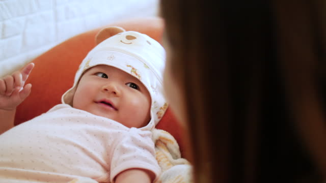 young mother and baby girl are so very cute - hugging self stock videos & royalty-free footage