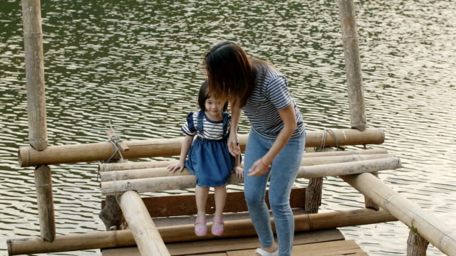 young mother and daughter enjoyment at pang oung, mae hong son province in thailand - mae hong son province stock videos and b-roll footage