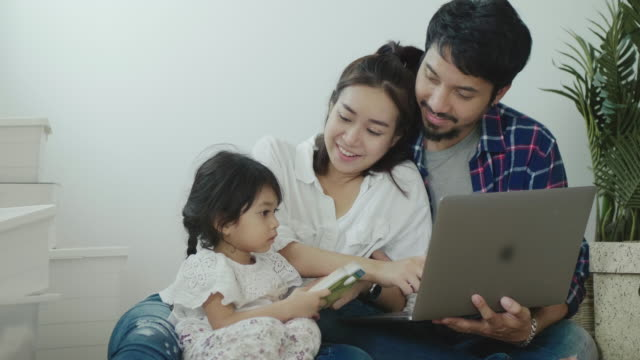 young mother and father in a new home with daughter - searching stock videos & royalty-free footage