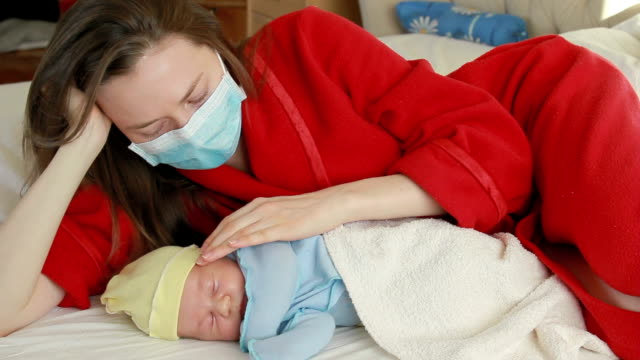 young mother and newborn baby - tranquil scene stock videos & royalty-free footage