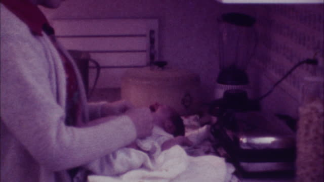 young mother changes baby - 70's 8mm film - nostalgia stock videos & royalty-free footage