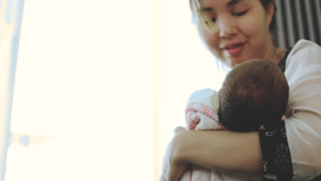 young mother holding her newborn baby - hugging self stock videos & royalty-free footage