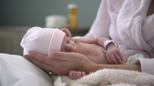 cu young mother holding her newborn baby - soft blanket stock videos and b-roll footage