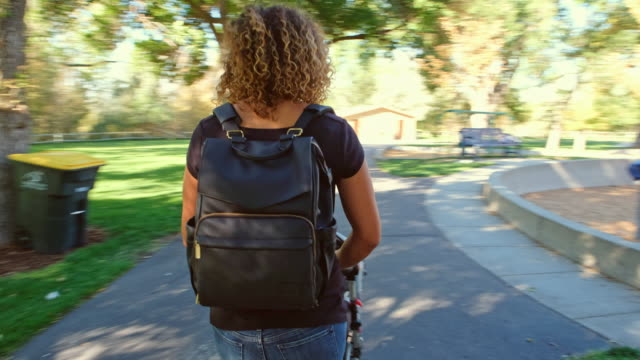 young mother in the park - nappy bag stock videos & royalty-free footage