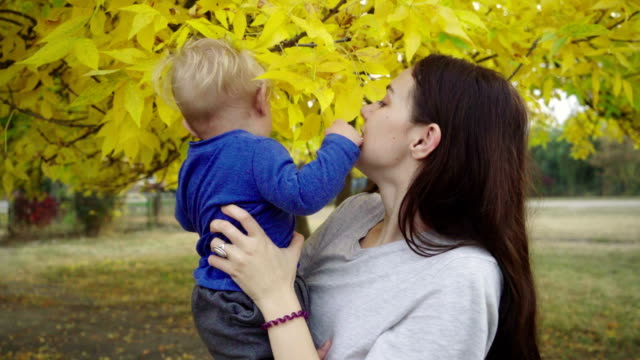 young mother playing with child - blonde hair stock videos & royalty-free footage