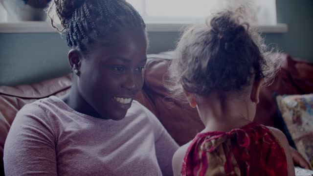 cu young mother playing with her daughter at home - braided hair stock videos & royalty-free footage
