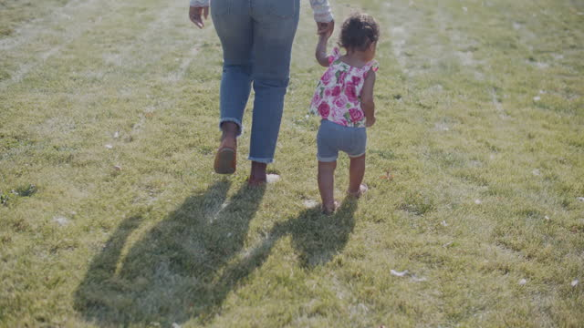 young mother walking with her baby girl - toddler stock videos & royalty-free footage