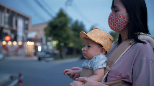 young mother walks with her son on sidewalk - 6 11 months stock videos & royalty-free footage