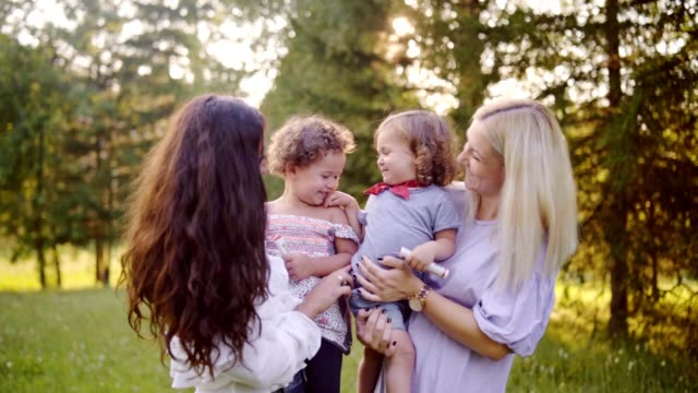 young mothers spending time in nature with daughters - family with two children stock videos & royalty-free footage