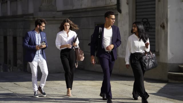young multi ethnic business men and women walking out to viewpoint of city - ticino canton stock videos and b-roll footage