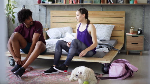 young multi-ethnic couple preparing for jogging - untied stock videos and b-roll footage