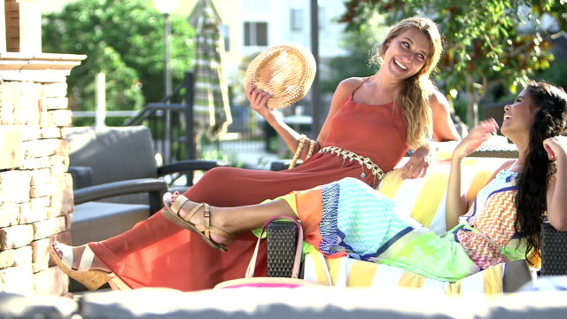 young multi-ethnic women relaxing, talking on patio - sundress stock videos & royalty-free footage