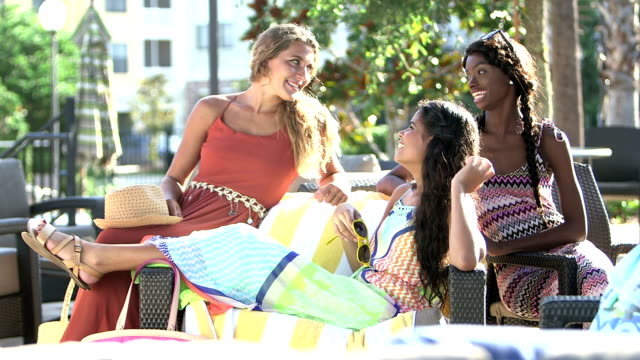 young multi-ethnic women relaxing, talking on patio - fashion model stock videos & royalty-free footage