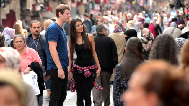 Young multinational tourist couple on crowded Istanbul street