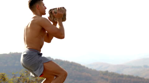young muscular bodybuilder training with rock - picking up stock videos & royalty-free footage
