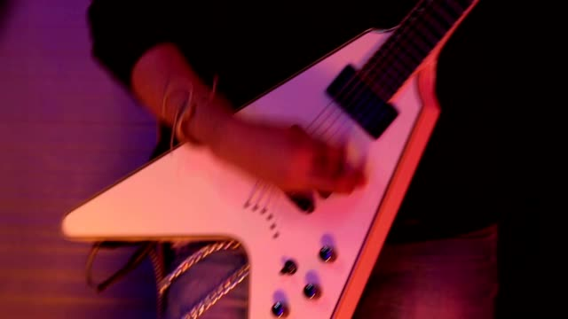 cu young musician playing guitar in nightclub / india - electric guitar stock videos and b-roll footage