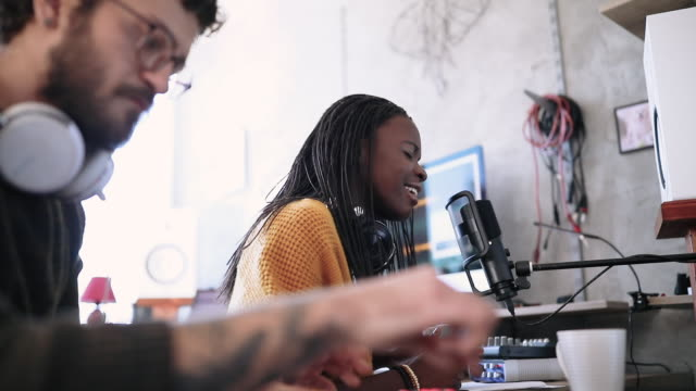 young musicians making recordings in studio - producer stock videos & royalty-free footage