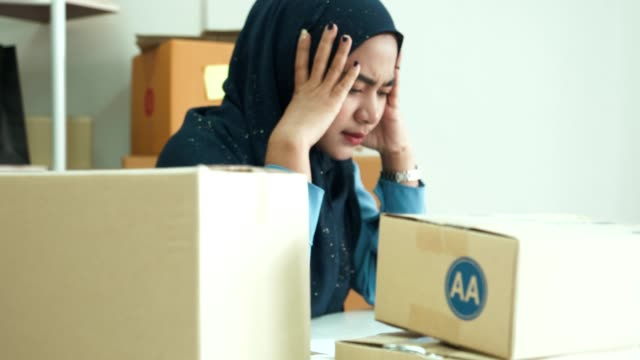 young muslim business women work until stress - infamous stock videos & royalty-free footage