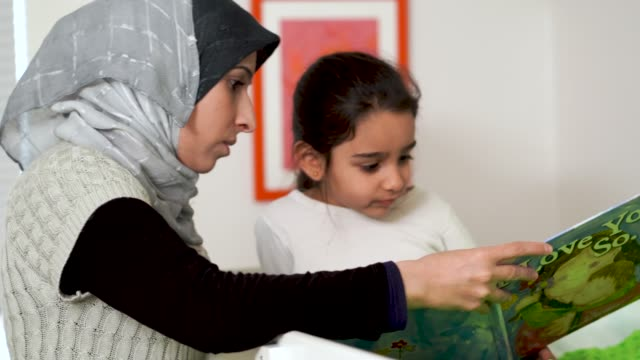 a young muslim girl enjoying bed time with her mom - brother stock videos & royalty-free footage