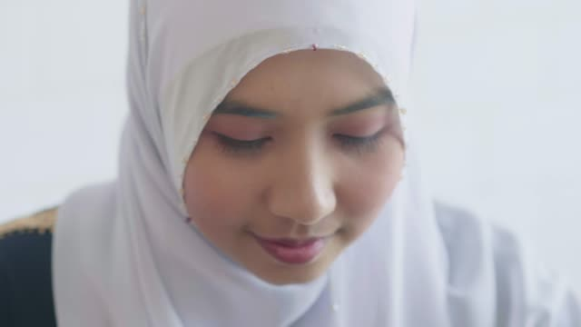 young muslim woman learning technology - religious dress stock videos & royalty-free footage