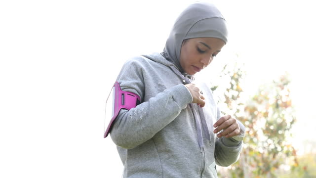 young muslim woman ready to running in the city - hijab stock videos & royalty-free footage