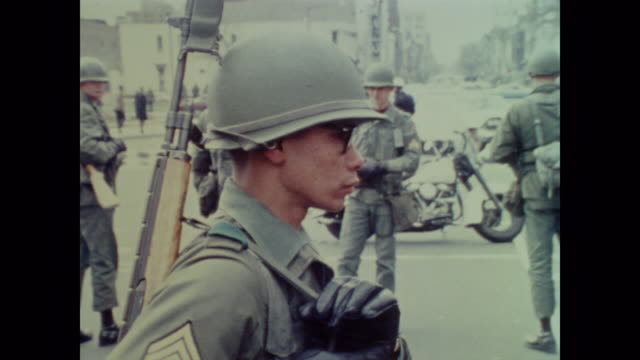 young national guard soldiers walk down the center of downtown dc as they patrol in the wake of the 1968 riots - 1968 stock videos & royalty-free footage