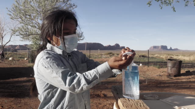 a young navajo boy applying hand sanitizer to help protect him from coronavirus - navajo culture stock videos & royalty-free footage
