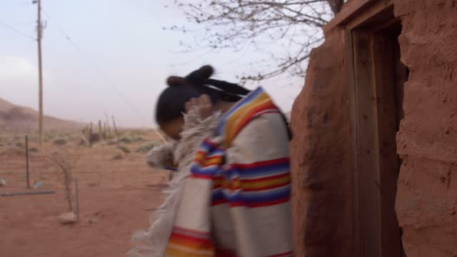 young navajo family walking out of their hogan wearing masks to help prevent covid-19 - navajo culture stock videos & royalty-free footage