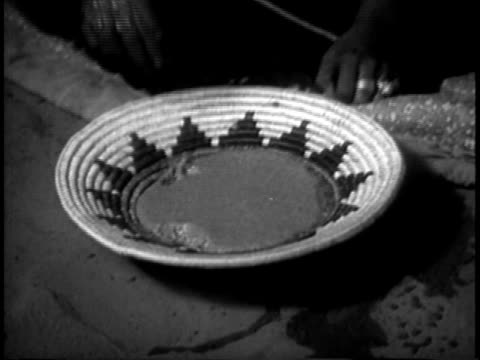 1939 montage ms young navajo man and woman having dinner together in navajo hogan / southwest united states / audio - native american reservation stock videos & royalty-free footage