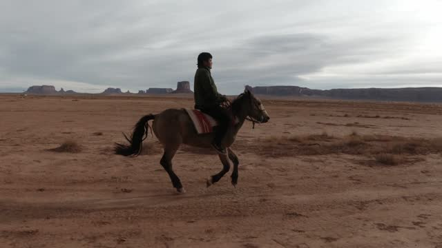 young navajo teenager riding his horse - indigenous north american culture stock videos & royalty-free footage