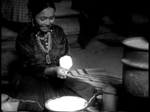 1939 montage ms cu young navajo woman kneading bread in navajo hogan / southwest united states / audio - navajo culture stock videos & royalty-free footage
