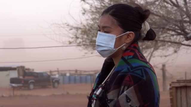 young navajo woman wearing a mask to help prevent covid-19 - indigenous north american culture stock videos & royalty-free footage