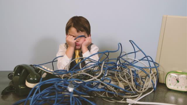 young nerd boy at it help desk - soluzione video stock e b–roll
