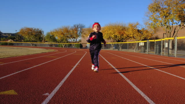young nerd boy at track running - running track stock videos & royalty-free footage
