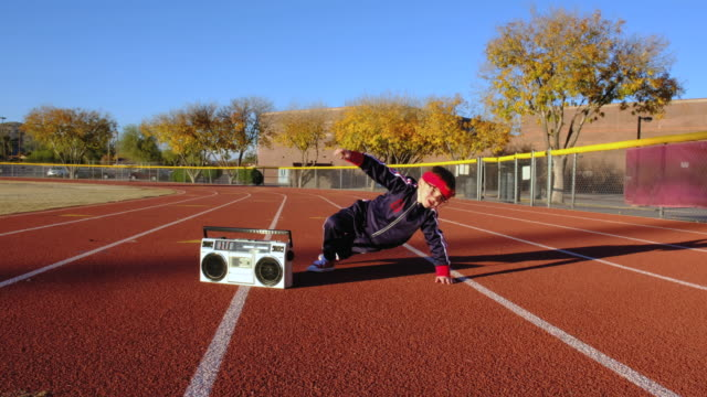 young nerd boy at track stretching - portable stereo stock videos & royalty-free footage