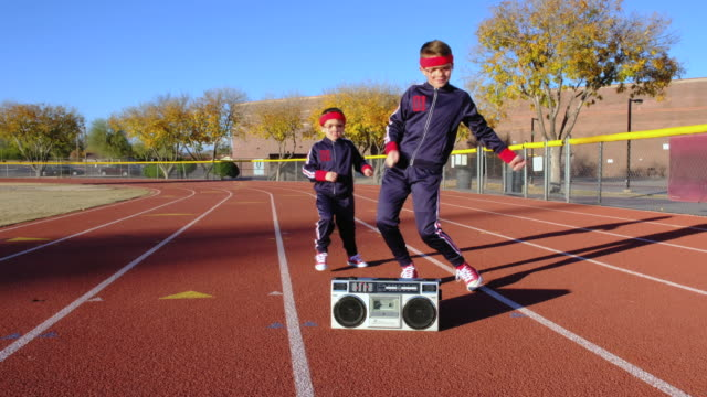 young nerd boys at track hip-hop dancing - portable stereo stock videos & royalty-free footage