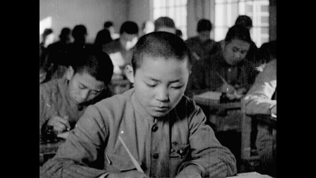 / young north korean students in school / coastal landscape / people working on group construction project / men laying bricks. education and work in... - anno 1947 video stock e b–roll