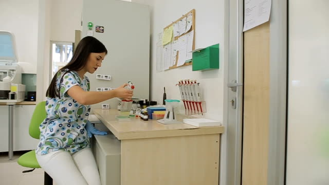 young nurse  holds and examine samples in biochemistry laboratory - medical test stock videos & royalty-free footage