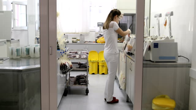 young nurse in laboratory working on filtering blood and plasma - blood donation stock videos & royalty-free footage