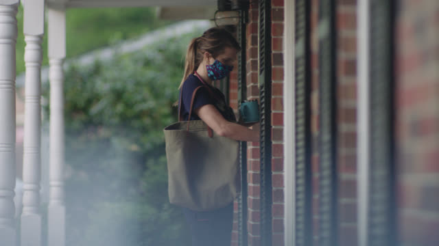 stockvideo's en b-roll-footage met young nurse leaving her house for work. - north carolina amerikaanse staat