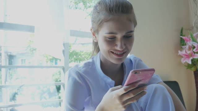 young nurse using phone