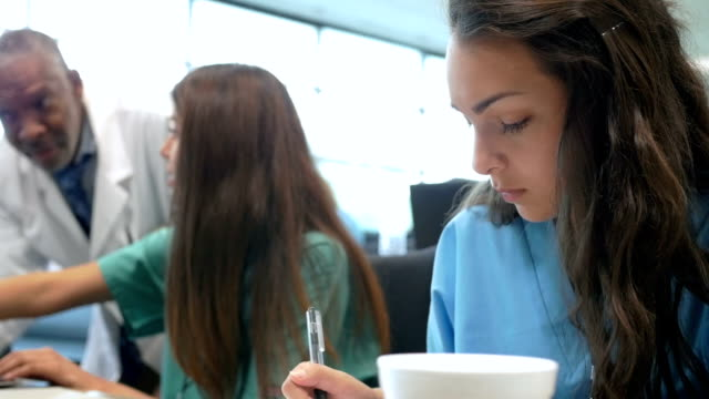 young nursing or medical students in college class with medical professor - medical student stock videos and b-roll footage